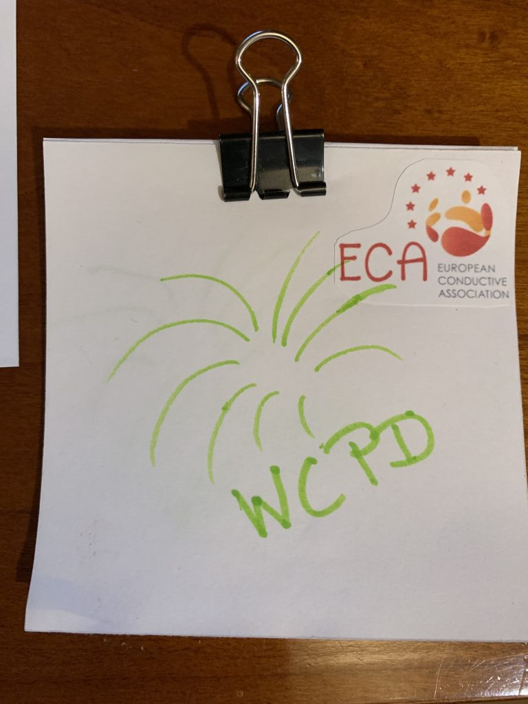 A stack of papers held together with office clip. The Logo of ECA is glued on the cover paper right. WCPD is written by hand in green across the page with a drawn firework explosion.