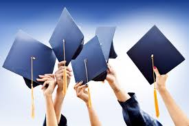 Picture of 5 hands holding their graduate hats up into the air.